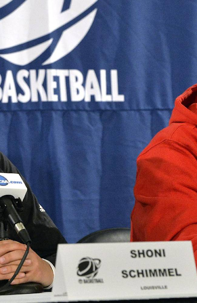 Louisville head coach Jeff Walz, right, and Shoni Schimmel listen to a reporters question during a news conference for the Louisville Regional final in the women's NCAA college basketball tournament Monday, March 31, 2014, in Louisville, Ky. Louisville plays Maryland on Tuesday
