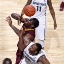 Minnesota's Trevor Mbakwe, top, and Michigan State's Derrick Nix vie for a rebound during the first half of an NCAA college basketball game, Wednesday, Feb. 6, 2013, in East Lansing, Mich. (AP Photo/Al Goldis)