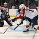 Florida Panthers left wing Jonathan Huberdeau, front, feeds puck to right wing Brad Boyes for the winning goal in overtime against the Colorado Avalanche in an NHL hockey game in Denver on Tuesday, Oct. 21, 2014. The Panthers won 4-3 The Associated Press
