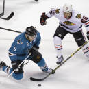 San Jose Sharks center Joe Pavelski (8) and Chicago Blackhawks center Andrew Shaw (65) vie for the puck during the second period of an NHL hockey game Saturday, Jan. 31, 2015, in San Jose, Calif. (AP Photo/Eric Risberg)