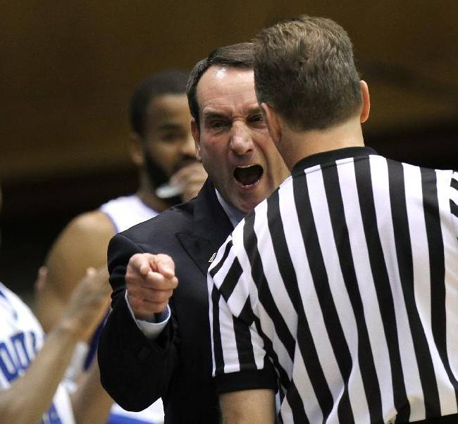 Duke head coach Mike Krzyzewski disputes a call during the first half of an NCAA college basketball game against UNC-Asheville in Durham, N.C., Monday Nov. 18, 2013