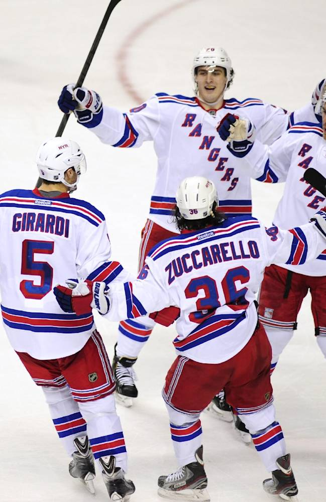The New York Rangers celebrate a goal by defenseman Ryan McDonagh, right, in the second period of an NHL hockey game against the Nashville Predators, Saturday, Nov. 23, 2013, in Nashville, Tenn