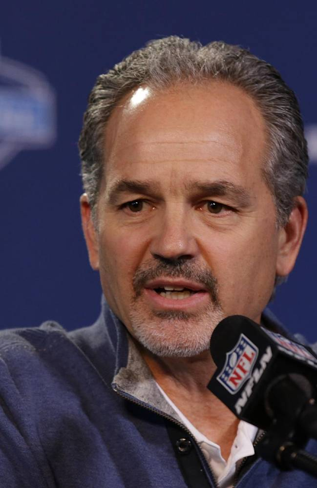 Indianapolis Colts head coach Chuck Pagano answers a question during a news conference at the NFL football scouting combine in Indianapolis, Friday, Feb. 21, 2014