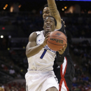 Creighton's Austin Chatman (1) drives past Creighton's Isaiah Zierden (21) during the first half of a second-round game in the NCAA college basketball tournament Friday, March 21, 2014, in San Antonio. (AP Photo/David J. Phillip)