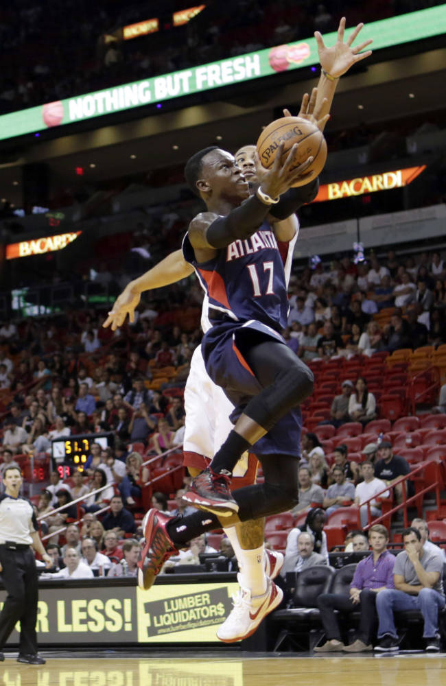 Atlanta Hawks' Dennis Schroder (17) prepares to shoot as Miami Heat's Charlie Westbrook defends in the fourth quarter of an NBA preseason basketball game, Monday, Oct. 7, 2013, in Miami. The Heat won 92-87