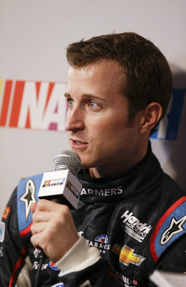 Driver Kasey Kahne talks with reporters during NASCAR auto racing media day at Daytona International Speedway in Daytona Beach, Fla., Thursday, Feb. 13, 2014