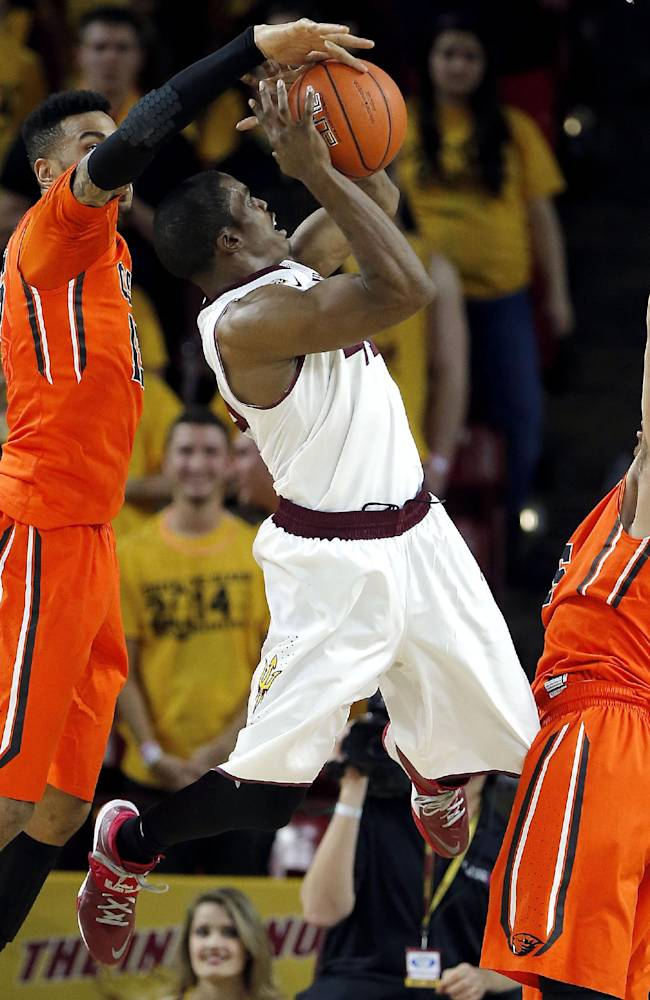 Arizona State's Shaquielle McKissic, center, shoots between Oregon State's Roberto Nelson, right, and Eric Moreland during the first half of an NCAA college basketball game, Thursday, Feb. 6, 2014, in Tempe, Ariz