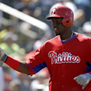 Philadelphia Phillies' John Mayberry Jr. celebrates after scoring the tying run in the eighth inning of an exhibition baseball game against the Minnesota Twins in Fort Myers, Fla., Sunday, March 9, 2014. The game ended in a 1-1 tie The Associated Press