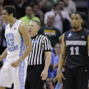 North Carolina's James Michael McAdoo (43) celebrates a rebound against Providence in the final seconds of the second half of a second-round game in the NCAA college basketball tournament Friday, March 21, 2014, in San Antonio. McAdoo's free throws lifted North Carolina to a 79-77 win. (AP Photo/Eric Gay)