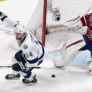 Tampa Bay Lightning's Brett Connolly celebrates after scoring past Montreal Canadiens goalie Carey Price during the second period of an NHL hockey game Tuesday, Jan. 6, 2015, in Montreal The Associated Press