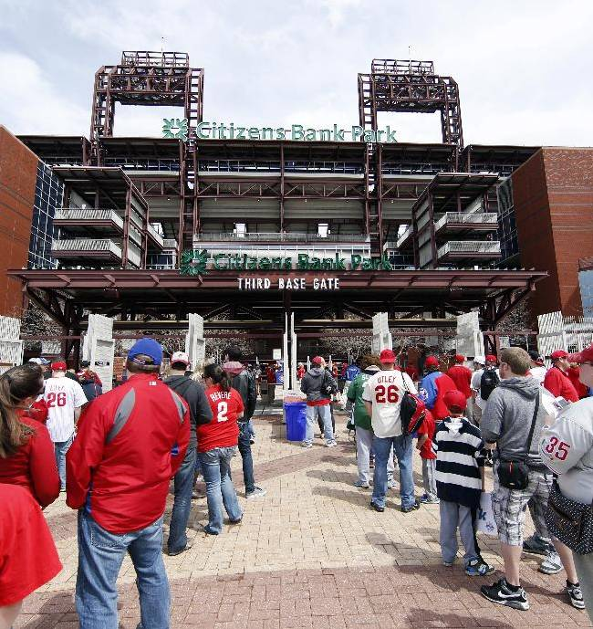Fans wait to head into the stadium for an opening day baseball game between the Milwaukee Brewers and Philadelphia Phillies in Philadelphia, Tuesday, April 8, 2014