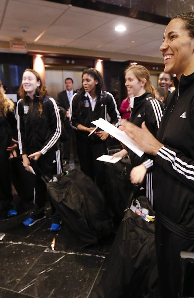 Notre Dame forward Taya Reimer, right, and teammates listen to a greeting as they arrive at the team hotel for the NCAA women's Final Four college basketball tournament Thursday, April 3, 2014, in Nashville, Tenn. Notre Dame is scheduled to play Maryland in a semifinal on Sunday