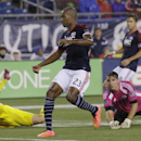 Columbus Crew midfielder Ethan Finlay (13) falls face-down onto the pitch as New England Revolution defender Jose Goncalves (23), keeper Bobby Shuttleworth (22) and defender Chris Tierney (8) watch Finlay's shot roll into the back of the goal during the f