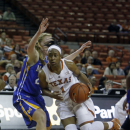 Texas guard Empress Davenport (1) drives to the basket against McNeese State guard Amber Donnes (23) during the second half of an NCAA college basketball game, Wednesday, Dec. 17, 2014, in Austin, Texas. (AP Photo/Michael Thomas)