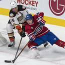 Montreal Canadiens' Brendan Gallagher is stopped by Anaheim Ducks' Ryan Getzlaf as he tries to score on the wrap-around during the second period of an NHL hockey game, Thursday, Dec. 18, 2014, in Montreal. (AP Photo/The Canadian Press, Paul Chiasson)
