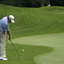 Shaun Micheel hits to the second green during a practice round for the PGA Championship golf tournament at Oak Hill Country Club, Tuesday, Aug. 6, 2013, in Pittsford, N.Y. (AP Photo/Charles Riedel)