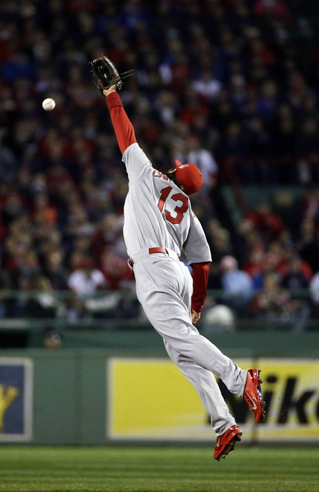 St. Louis Cardinals' Matt Carpenter cannot make a play on ball hit by  Boston Red Sox's David Ross during the second inning of Game 1 of baseball's World Series Wednesday, Oct. 23, 2013, in Boston