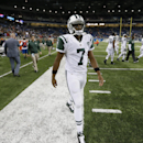 New York Jets quarterback Geno Smith walks off the field after their 38-3 loss to the Buffalo Bills in an NFL football game in Detroit, Monday, Nov.24, 2014. (AP Photo/Paul Sancya)