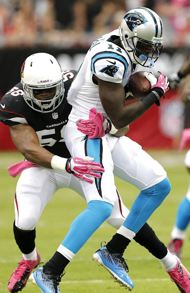Carolina Panthers wide receiver Brandon LaFell (11) is tackled by Arizona Cardinals linebacker Daryl Washington (58) during the first half of a NFL football game, Sunday, Oct. 6, 2013, in Glendale, Ariz