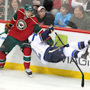 Minnesota Wild right wing Nino Niederreiter (22) takes down St. Louis Blues center Derek Roy (12) during the third period of their NHL hockey game Sunday, March 9, 2014 in St. Paul, Minn.. The Blues defeated the Wild 3-2 in a shootout The Associated Press