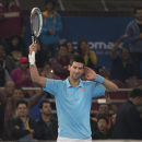 Musafir.com UAE Royals Novak Djokovic gestures to the crowd after winning a point against Micromax Indian Aces player Roger Federer during the International Premier Tennis League, in New Delhi, India, Monday Dec. 8, 2014. (AP Photo/Manish Swarup)