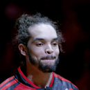 Chicago Bulls center Joakim Noah reacts to winning the NBA's 2014 Defensive Player Of The Year Award before Game 2 in an opening-round NBA basketball playoff series game against the Washington Wizards Tuesday, April 22, 2014, in Chicago The Associated Pre
