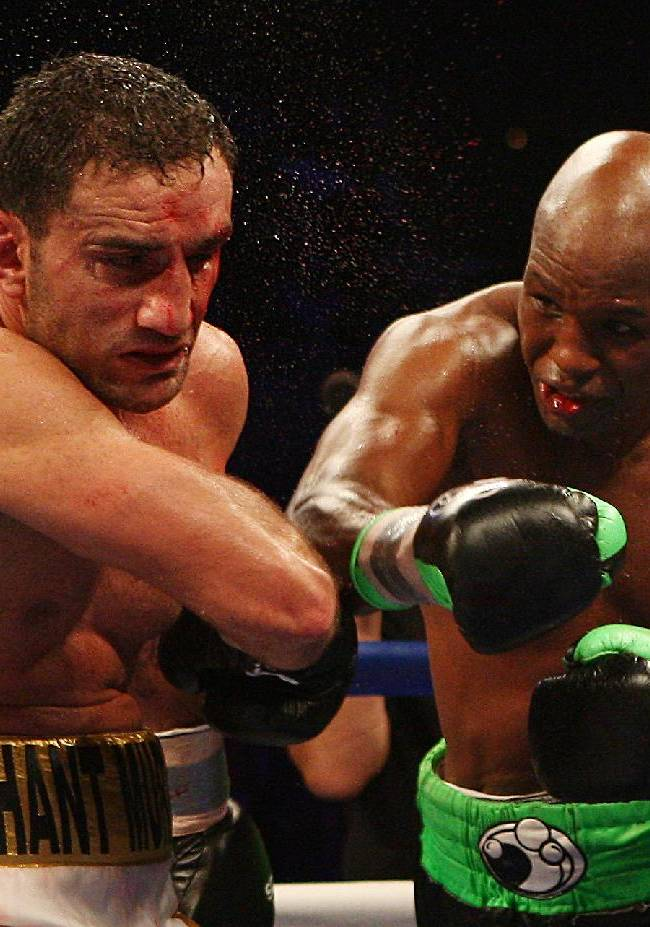 Bernard Hopkins, right, of Philadelphia, Penn. lands a punch on Karo Murat of Germany during the eleventh round of IBF Light Heavyweight Title in Atlantic City, N.J. on Saturday, Oct. 26, 2013. Hopkins won by unanimous decision after 12 rounds