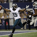 Philadelphia Eagles' LeSean McCoy (25) celebrates in front of Dallas Cowboys' Barry Church (42) as he sprints into the end zone for a touchdown during the second half of an NFL football game, Thursday, Nov. 27, 2014, in Arlington, Texas The Associated Pre