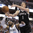 Brooklyn Nets forward Mason Plumlee (1) and Dallas Mavericks guard Vince Carter (25) reach for the ball during the first half of an NBA basketball game Sunday, March 23, 2014, in Dallas The Associated Press