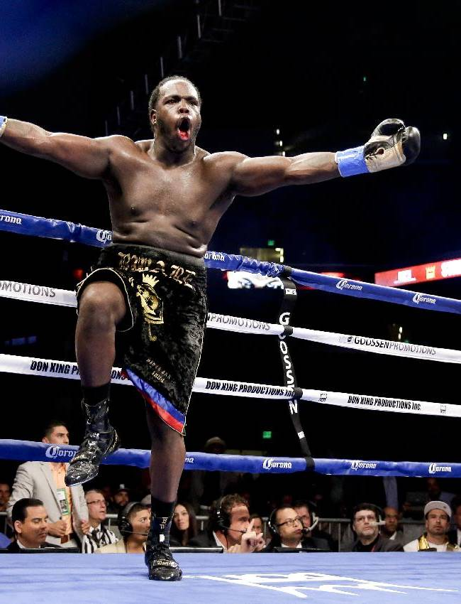 Bermane Stiverne celebrates after referee Jack Reiss stopped his fight against Chris Arreola during their rematch for the WBC heavyweight boxing title in Los Angeles, Saturday, May 10, 2014. Stiverne won the title