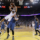 Golden State Warriors' Klay Thompson (11) scores over Minnesota Timberwolves' Kevin Love (42) and Ricky Rubio, left, during the second half of an NBA basketball game on Monday, April 14, 2014, in Oakland, Calif. Golden State won 130-120 The Associated Pre