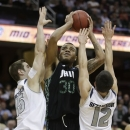Ohio's Reggie Keely, center, squeezes between Akron's Jake Kretzer, left, and Carmelo Betancourt during the first half of an NCAA college championship basketball game in the Mid-American Conference tournament on Saturday, March 16, 2013, in Cleveland. (AP Photo/Tony Dejak)