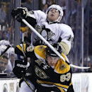 Pittsburgh Penguins left wing James Neal (18) crashes into Boston Bruins left wing Brad Marchand (63) along the boards in the third period of an NHL hockey game in Boston, Monday, Nov. 25, 2013. The Bruins won 4-3 in overtime The Associated Press