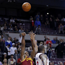 Cleveland Cavaliers guard Dion Waiters, left, shoots the game-winning shot against Detroit Pistons guard Rodney Stuckey, right, to defeat the Pistons 97-96 as the clock ran out during the fourth quarter of an NBA basketball game Wednesday, March 26, 2014,