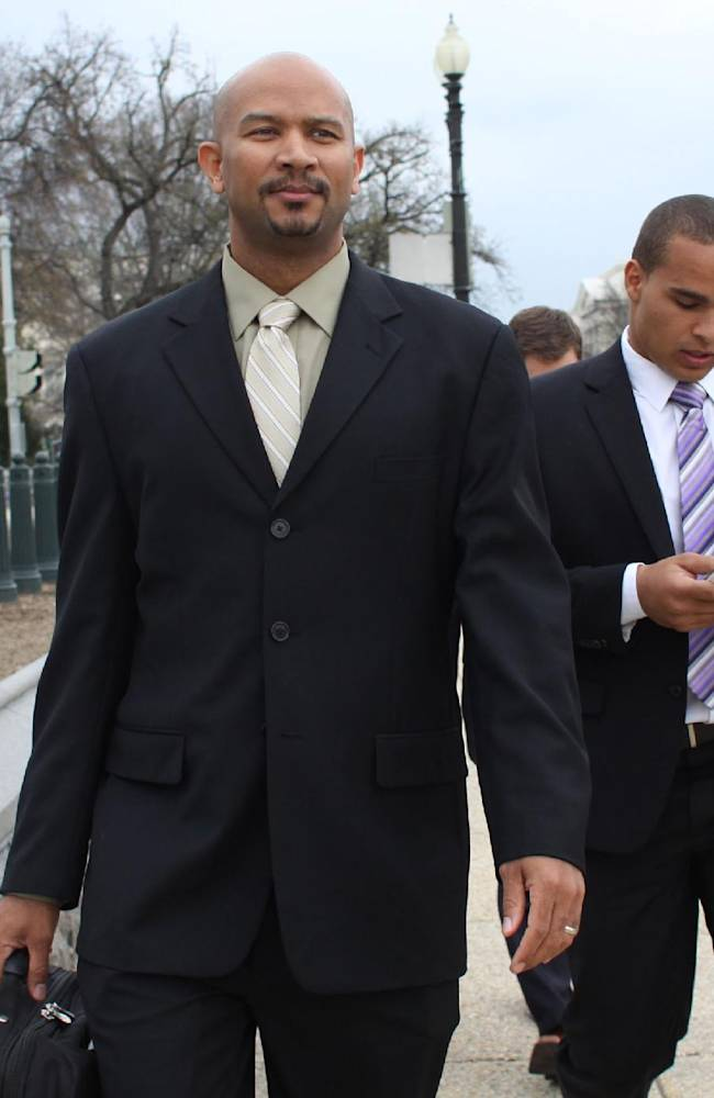 In this April, 2, 2014 file photo, former Northwestern football quarterback Kain Colter, right, and Ramogi Huma, founder and president of the National College Players Association, arrive on Capitol Hill in Washington. Northwestern football players will cast secret ballots Friday, April 25, 2014, on whether to form the nation's first union for college athletes, a potentially landmark vote that will, however, be kept sealed for weeks or months, and possibly years. Colter announced in January that he would lead the drive to unionize. The CAPA would represent the players at the bargaining table if the pro-union side prevails