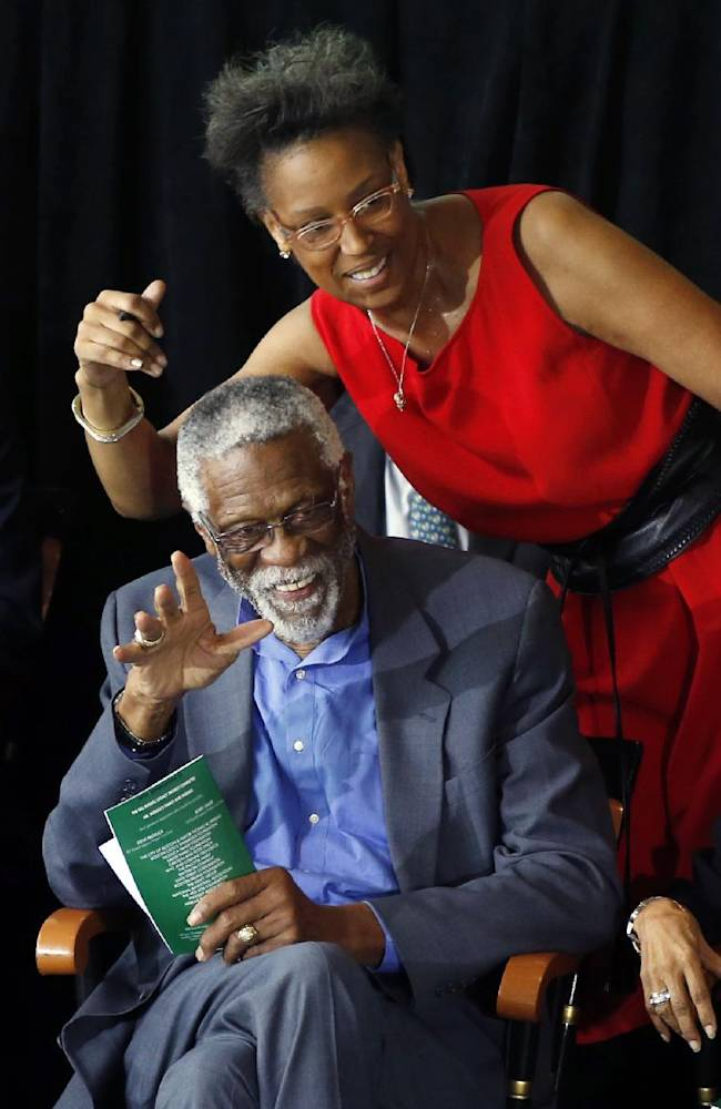 Former Boston Celtics basketball star Bill Russell waves alongside his daughter, Karen Kenyatta Russell, during a ceremony honoring him after a statue of him was unveiled at City Hall Plaza in Boston, Friday, Nov. 1, 2013