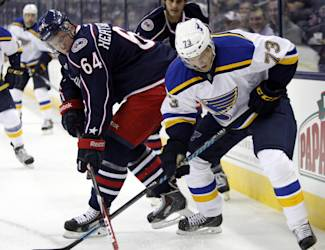 Columbus Blue Jackets' Dillon Heatherington, left, works for the puck against St. Louis Blues' Sebastian Wannstrom, of Sweden, during the first period of an NHL preseason hockey game in Columbus, Ohio, Sunday, Sept. 21, 2014. The Blue Jackets won 4-3 in overtime. (AP Photo/Paul Vernon)