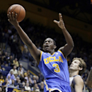 UCLA's Jordan Adams (3) lays up a shot past California's Ricky Kreklow during the first half of an NCAA college basketball game Wednesday, Feb. 19, 2014, in Berkeley, Calif. (AP Photo/Ben Margot)