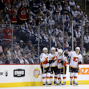 Calgary Flames' Kris Russell (4), Mason Raymond (21), Johnny Gaudreau (13) and Mikael Backlund (11) celebrate after Raymond scored during second period NHL hockey action in Winnipeg, Manitoba, Sunday, Oct. 19, 2014 The Associated Press