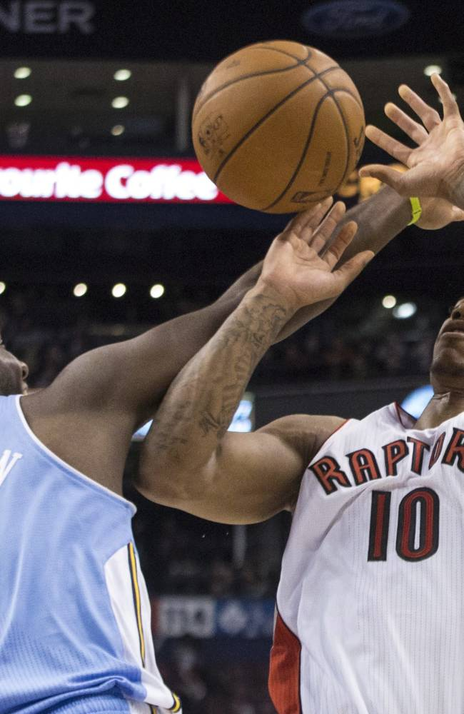Toronto Raptors' DeMar DeRozan, right, is fouled by Denver Nuggets' Jordan Hamilton during the second half of an NBA basketball game on Sunday, Dec. 1, 2013, in Toronto