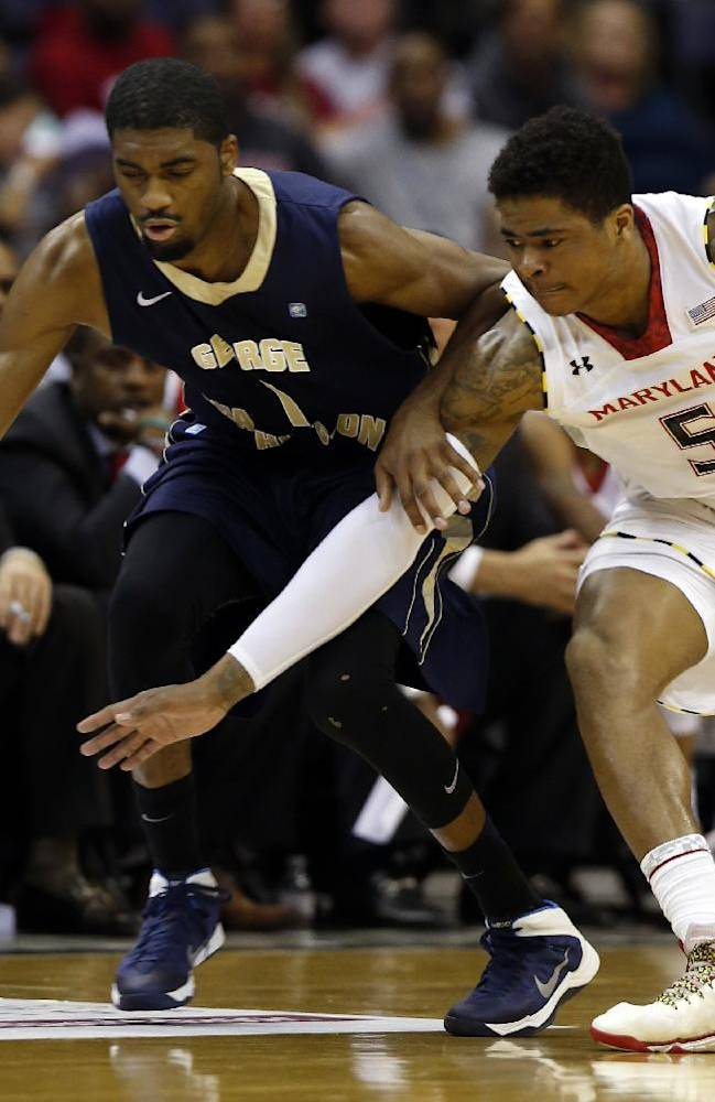 George Washington guard Maurice Creek (1) and Maryland guard Nick Faust (5) go for the ball during the first half of an NCAA college basketball game in the BB&T Classic, Sunday, Dec. 8, 2013, in Washington. George Washington won 77-75