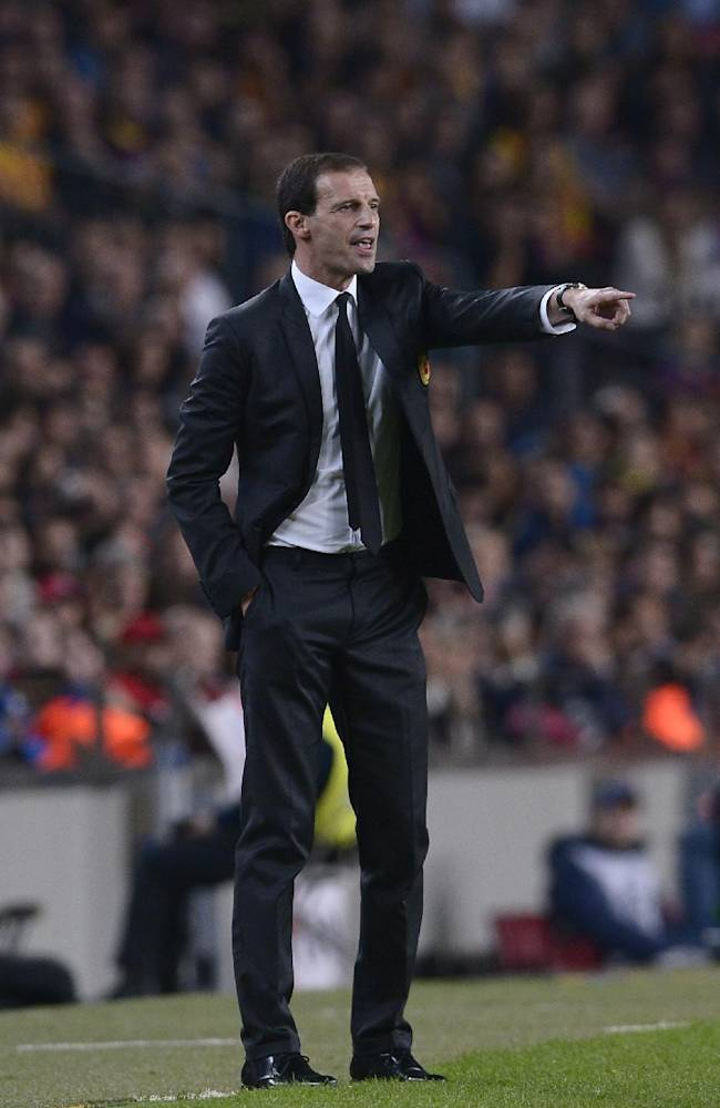 AC Milan coach Massimiliano Allegri gestures during the  Champions League group H soccer match between FC Barcelona and AC Milan, at the Camp Nou stadium, in Barcelona, Spain, Wednesday, Nov. 6, 2013