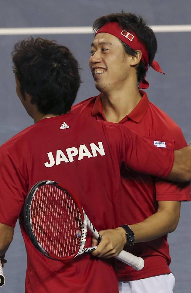 Kei Nishikori of Japan, right, celebrates with his compatriot Yasutaka Uchiyama following their win over Canada during their 1st round of Davis Cup World Group doubles tennis match in Tokyo, Saturday, Feb. 1, 2014. Japan won the match 6-3, 7-6 (3), 4-6, 6-4