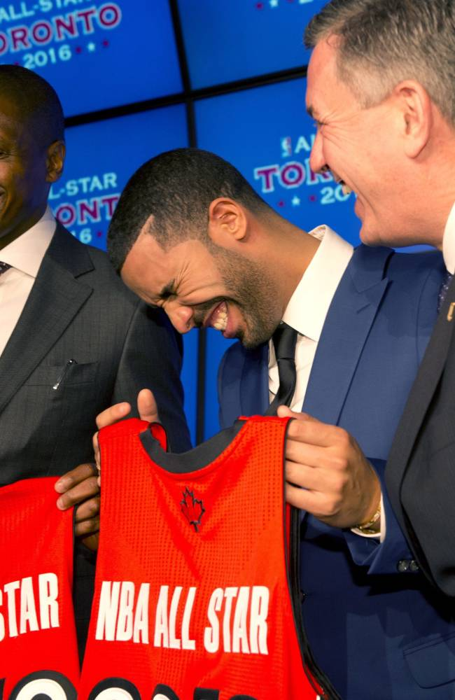 Toronto Raptors general manager Masai Uriji, left, Canadian recording artist Drake, center, and Maple Leaf Sports and Entertainment President and CEO Tim Leiweke laugh as they pose with jerseys after the announcement that the Raptors will host the 2016 NBA All Star game at a news conference in Toronto on Monday Sept. 30, 2013