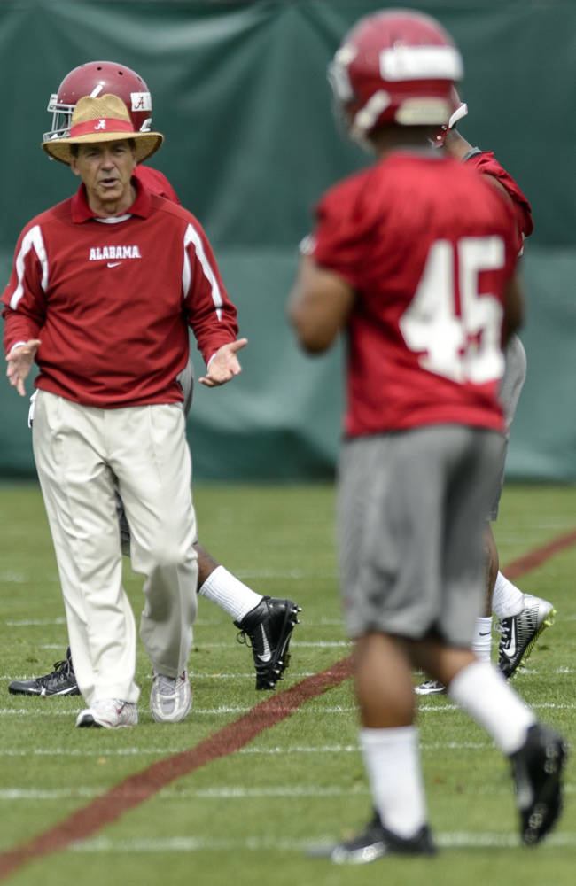Alabama head coach Nick Saban works with the defensive backs during spring NCAA college football practice, Saturday, March 15, 2014, at the Thomas-Drew Practice Facility in Tuscaloosa, Ala
