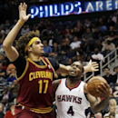 Atlanta Hawks forward Paul Millsap (4) is fouled as he tries to get past Cleveland Cavaliers center Anderson Varejao (17) in the first half of an NBA basketball game Friday, Dec. 6, 2013, in Atlanta The Associated Press