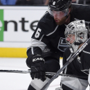 Los Angeles Kings goalie Jonathan Quick, lower right, tries to stop a shot along with defenseman Jake Muzzin during the third period of an NHL hockey game against the Chicago Blackhawks, Wednesday, Jan. 28, 2015, in Los Angeles. The Kings won 4-3 The Ass
