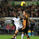 Hull City's Alex Bruce, right, and Swansea City's Nathan Dyer battle for the ball during their English Premier League match at the Liberty Stadium, Swansea, Wales, Monday, Dec. 9, 2013