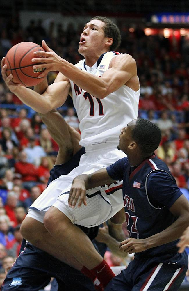Arizona's Aaron Gordon (11) goes between the defense of Fairleigh Dickinson for two in the first half of an college NCAA basketball game, Monday, Nov. 18, 2013 in Tucson, Ariz