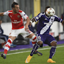 Arsenal's Santi Cazorla, left, and Anderlecht's Gohi Bi Zoro Cyriac, right, vie for the ball during the Group D Champions League match between Anderlecht and Arsenal at Constant Vanden Stock Stadium in Brussels, Belgium, Wednesday Oct. 22, 2014